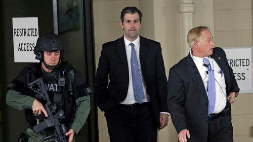 Former North Charleston police officer Michael Slager, center, is escorted from the courthouse during his murder trial at the Charleston County court in Charleston, S.C., Friday, Dec. 2, 2016. The case of a former South Carolina police officer charged with murder in the shooting death of an unarmed black motorist is now before the jury.