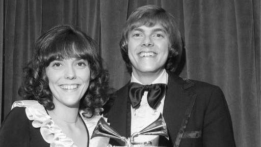 """FILE - This March 14, 1972 file photo shows Karen Carpenter, left, and Richard Carpenter, of The Carpenters, posing with their award for best pop vocal per during the 14th annual 1971 Grammy Awards in New York. Richard Carpenter sued Universal Music Group on Wednesday, Jan. 11, 2017, seeking more than $2 million in royalties he says are owed to him and the estate of his late sister for sales of digital music on services such as Apple's iTunes. The Carpenters won three Grammy Awards, including for  their song """"Close to You."""""""