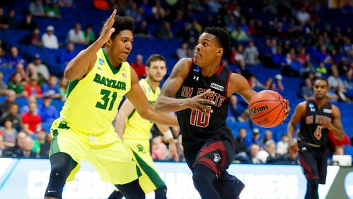 Baylor 's Terry Maston, left, defends a drive to the basket by New Mexico State's Jemerrio Jones in the first half of a first-round game in the men's NCAA college basketball tournament in Tulsa, Okla., Friday March 17, 2017.