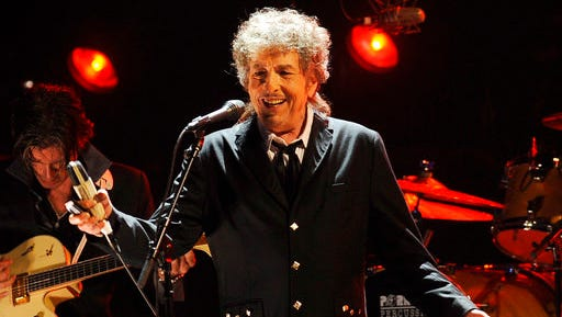 FILE - In this Jan. 12, 2012, file photo, Bob Dylan performs in Los Angeles. The Swedish Academy says 2016 Nobel literature winner Bob Dylan will meet with members of the academy this weekend and they will hand over his Nobel diploma and medal.