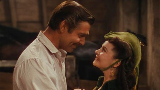 """This photo provided by Warner Bros. Home Entertainment shows Clark Gable, left,  as Rhett Butler, and Vivien Leigh as Scarlett O'Hara in a scene from the film, """"Gone With the Wind."""" The film's 75th anniversary will be celebrated over the next week, with special screenings and Warner Bros. Home Entertainment's release of a lavish new limited-edition box set."""