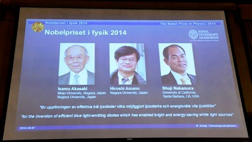 Projected images of  Isamu Akasaki, Hiroshi Amano and Shuji Nakamura  are displayed as it's announced at the Royal Swedish Academy of Science in Stockholm, Tuesday, that  the Nobel Prize in physics goes to Akasaki, Amano and Nakamura .