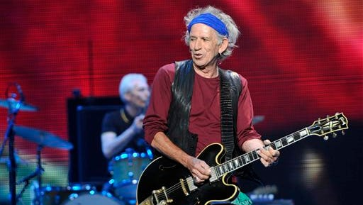 """This May 3, 2013 file photo shows Keith Richards of the Rolling Stones performing at the kick-off of the band's """"50 and Counting"""" tour in Los Angeles."""