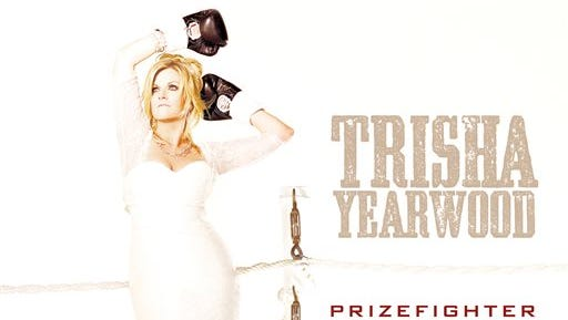 """This CD cover image released by Sony Music Nashville shows """"PrizeFighter: Hit After Hit,"""" by Trisha Yearwood. (AP Photo/Sony Music Nashville)"""