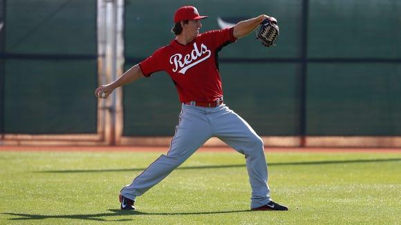 Reds pitcher Michael Lorenzen warms up during practice