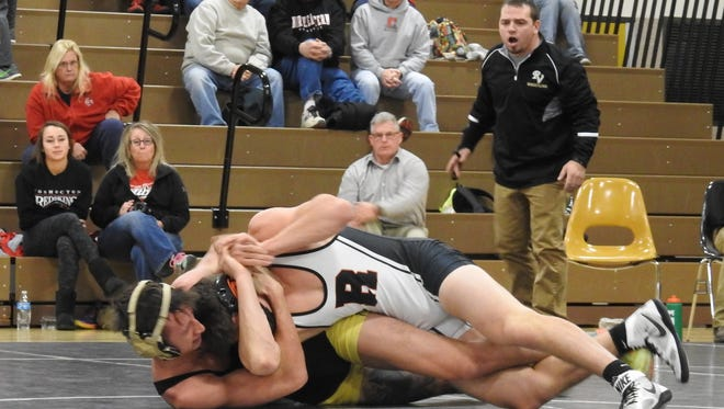 River View's Brody Bookless grapples with Ridgewood's Javon Merril. The Black Bears won the Coshocton County Tri Thursday.