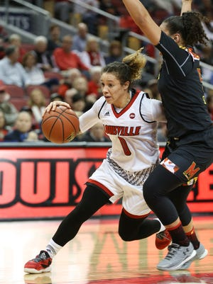 U of L's Briahanna Jackson (0) drives against Maryland's Destiny Slocum (5) during their game at the KFC Yum! Center.  Dec. 1, 2016