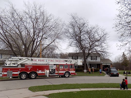 De Pere Ladder 111 assisted in rescuing a cat from