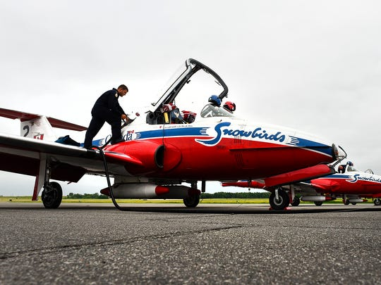 Members of the Snowbirds, Canada's military air show demonstration team, make a stop at the St. Cloud Regional Airport Tuesday, June, 13, because of the weather and to get fuel. The team is headed to Gaylord, Michigan,Êfor the Wings Over Northern Michigan air show.Ê
