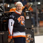 RIT Presedent Bill Destler laughs as he arrives on a zamboni to the ceremony of the dedication of RIT's new hockey arena, the Gene Polisseni Center.