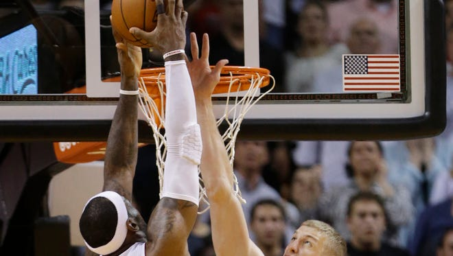 Brooklyn Nets forward Mason Plumlee (1) blocks a shot by Miami Heat forward LeBron James (6) in the final seconds of the second half of an NBA basketball game, Tuesday, April 8, 2014 in Miami. The Nets defeated the Heat 88-87.