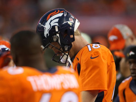 Denver Broncos quarterback Peyton Manning (18) reacts on the sidelines during the second half against the Kansas City Chiefs at Sports Authority Field at Mile High. The Chiefs won 29-13.