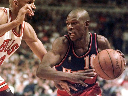 Ron Harper (left), father of the newest Rutgers pledge, plays defense for the Chicago Bulls in this 1997 photo.