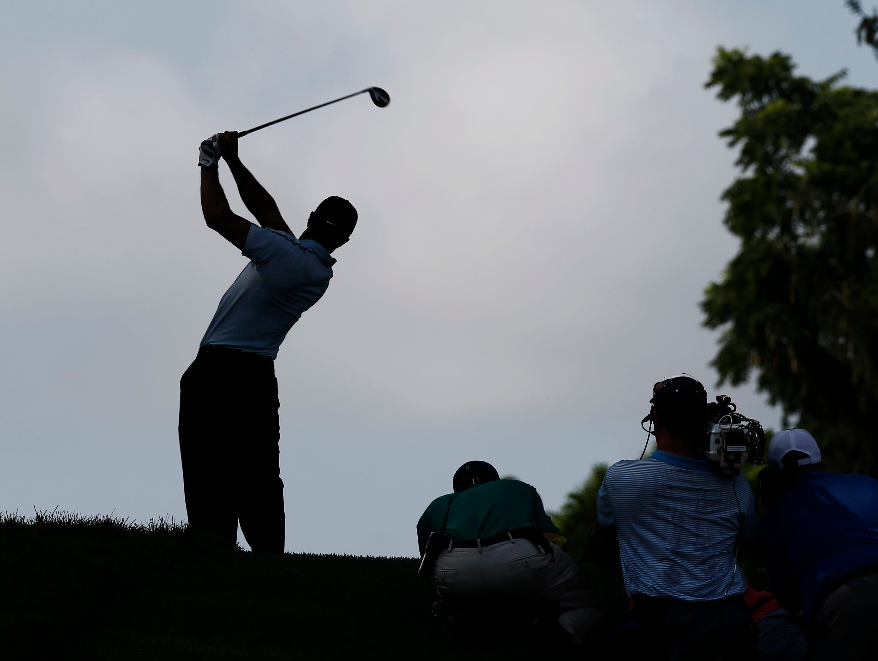 Tiger Woods tees off on the 16th tee.