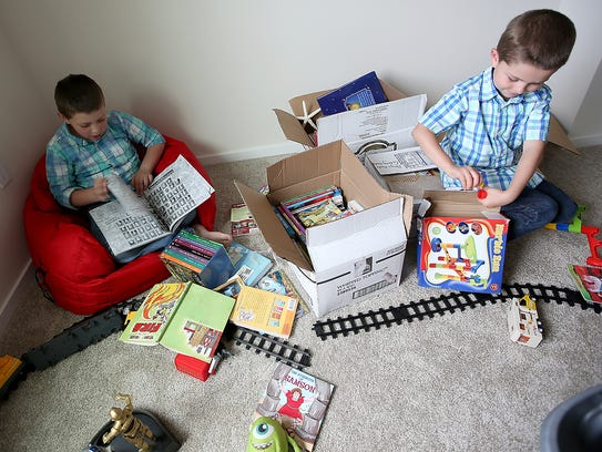 Gavin Mitchell, 9, (left) and brother Hudson, 5, unpack