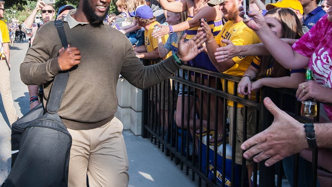 LSU Tigers running back Leonard Fournette greeting the fans coming down Victory Hill on Saturday October 15, 2016.