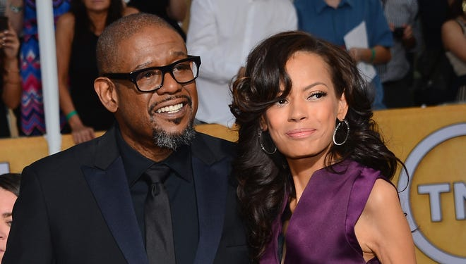 Forest Whitaker and wife Keisha Whitaker l He was shut out of the Golden Globes and the Oscars for his work in 'The Butler,' but he showed up at the SAGs with wife Keisha to celebrate his nomination for best actor in the Lee Daniels-directed pic.