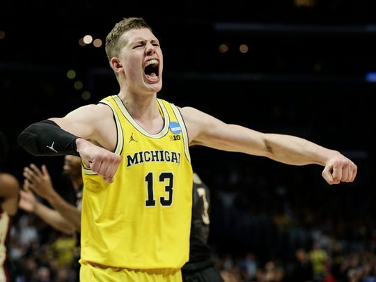 Michigan's Moritz Wagner celebrates a play during the