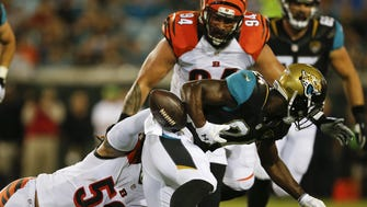 Bengals middle linebacker Rey Maualuga (58) forces Jaguars running back T.J. Yeldon to fumble in the first quarter.