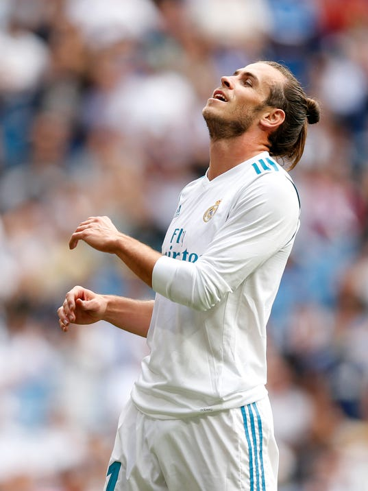 Real Madrid's Gareth Bale gestures after missing a chance during the Spanish La Liga soccer match between Real Madrid and Levante at the Santiago Bernabeu stadium in Madrid, Saturday, Sept. 9, 2017. The match ended in a 1-1 draw. (AP Photo/Francisco Seco)