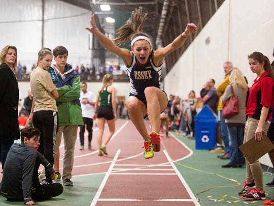 Essex's Jenna Puleo leaps into the pit in the Division I girls long jump during the Vermont indoor track state championships on Saturday at Norwich University.