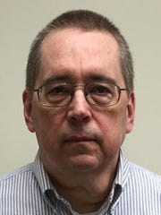 Father David Poulson was charged with indecent assault,