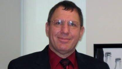 Dr. Charles Prijatelj