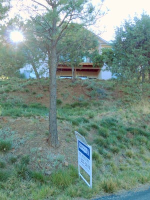 With many second home owners, house for sale signs are plentiful in Ruidoso during tourist seasons.