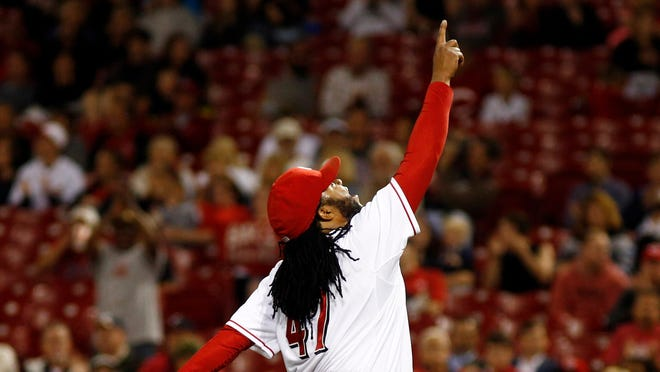 Cincinnati Reds starting pitcher Johnny Cueto points to the sky in the eighth inning of a baseball game against the Milwaukee Brewers, Tuesday, Sept. 23, 2014, in Cincinnati. The Reds won 3-1. (AP Photo/David Kohl)