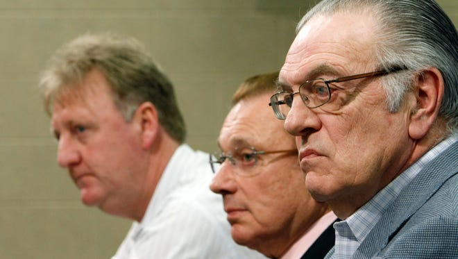 FILE - Indiana Pacers' CEO and President Donnie Walsh, right, sits with team owner Herb Simon, center, and Larry Bird, left.