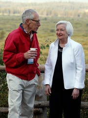 Federal Reserve Chair Janet Yellen, right, talks with