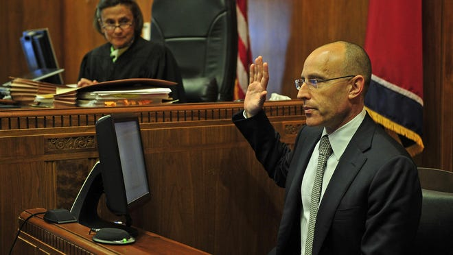 Dr. David Lubarsky, right, takes the oath to testify before Chancellor Claudia Bonnyman during on Tuesday in Nashville.