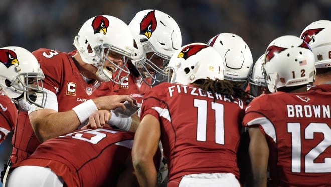 Jan 24, 2016: Arizona Cardinals quarterback Carson Palmer (3) calls up plays to his team during the second quarter against the Carolina Panthers in the NFC Championship football game at Bank of America Stadium.