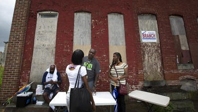 Behavioral Health System Baltimore workers talk about naloxone and overdose with people on the streets in July 2016.