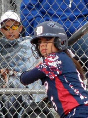 Sophomore Mireya Trujillo locks in on a pitch for the Lady Cats. Trujillo drove in five Lady Cats during the Rio Rancho High Tournament this past weekend.