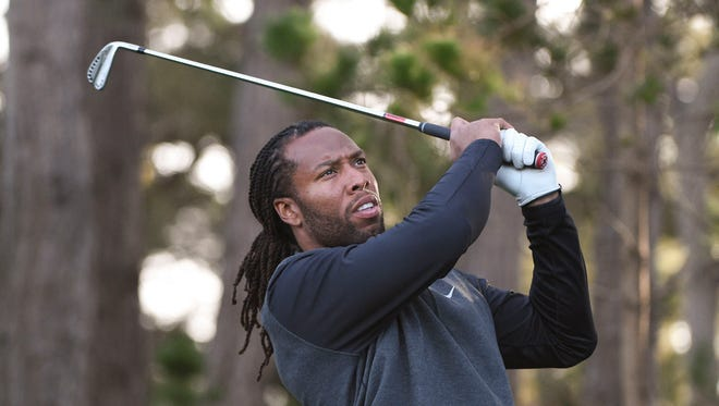 February 11, 2016: Larry Fitzgerald hits his tee shot on the second hole during the first round of the AT&T Pebble Beach National Pro-Am at Spyglass Hill Golf Course.