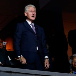 Former U.S. President Bill Clinton (C) attends the first day of the 2016 Democratic National Convention in Philadelphia.