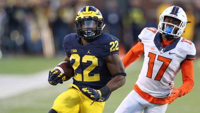 Michigan's Karan Higdon runs by Illinois' Stanley Green scoring a touchdown in the fourth quarter of U-M's 41-8 win Saturday at Michigan Stadium.