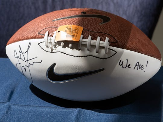 A football signed by head football coach James Franklin is on display during the PSU coaches caravan at Penn State York.