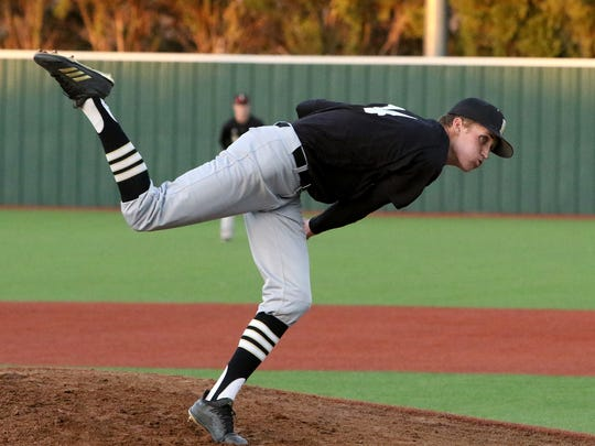 Rider's Logan Wissinger pitches against Wichita Falls High School Tuesday, March 20, 2018, at Hoskins Field. The Raiders defeated the Coyotes 11-0.