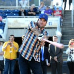 Two-time Masters Champion Bubba Watson hits a ball with a pink bat Monday at Blue Wahoos Stadium after announcing that he is part owner of the Pensacola Blue Wahoos with Quint and Rishy Studer.
