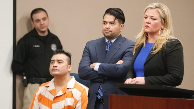 Hisaias Justo Lopez sits as his attorneys argue a point with District Court Judge Gonzalo Garcia during a hearing April 5, when Lopez turned down a plea deal and opted to go to trial in connection with the stabbing death of an off-duty U.S. Border Patrol agent last year.