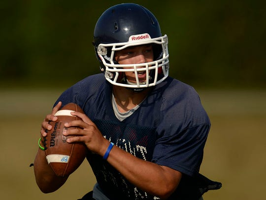 Bay Port quarterback Alec Ingold looks to make a pass during Friday's practice.