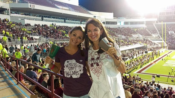 Donna Echols (right) and her bulldog buddy Meredith Broyles were part of the world record breaking cowbell ringing crowd.