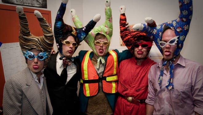 Eclectic Baltimore rock band The Snails in their characteristic headgear.