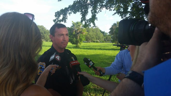 Naples police Lt. Seth Finman briefs the media on two bodies found in a wooded area off 700 Goodlette Road North.