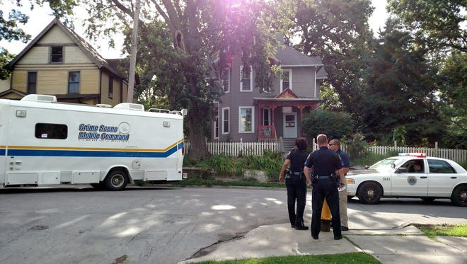 Des Moines police respond Monday, July 18, 2016, to an assault at Seventh Street and Indiana Avenue. A suspect was arrested Tuesday, July 19, 2016.