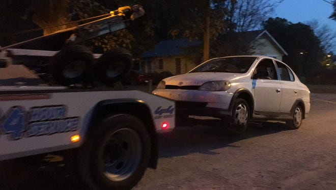 A vehicle driven by a man shot by police on Sunday is towed for evidence.
