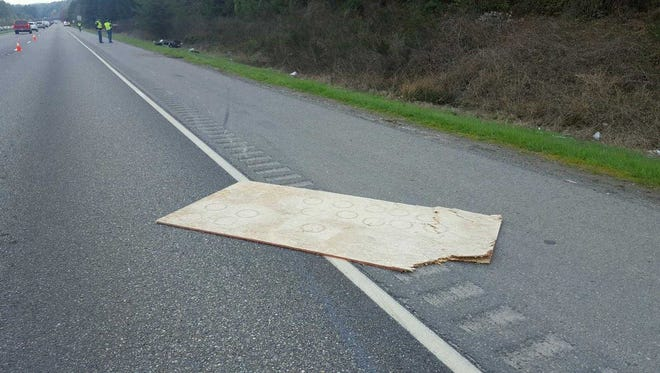 Washington State Patrol provided this image of the piece of plywood that fell from a truck and struck a motorcyclist