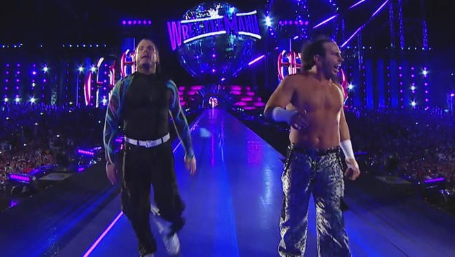 At this moment, Matt (right) and Jeff Hardy were six-time WWE tag team champions. By the end of there surprise entry into a ladder match, they had added to their total.